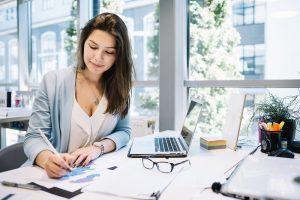 Cheerful Woman Writing a Blog